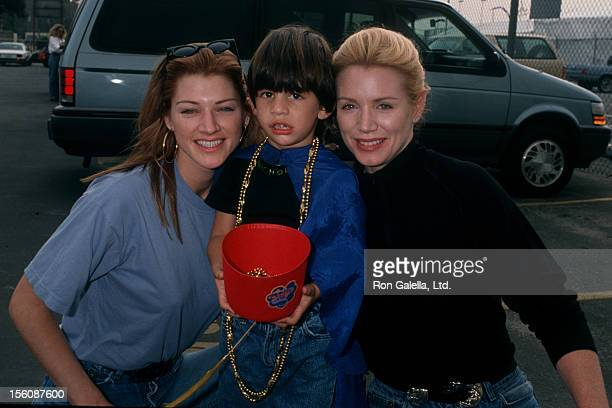 Actresses Shannon Tweed and sister Tracy Tweed and son Nick Simmons attending the premiere of 'Aladdin' on November 8 1992 at El Capitan Theater in...