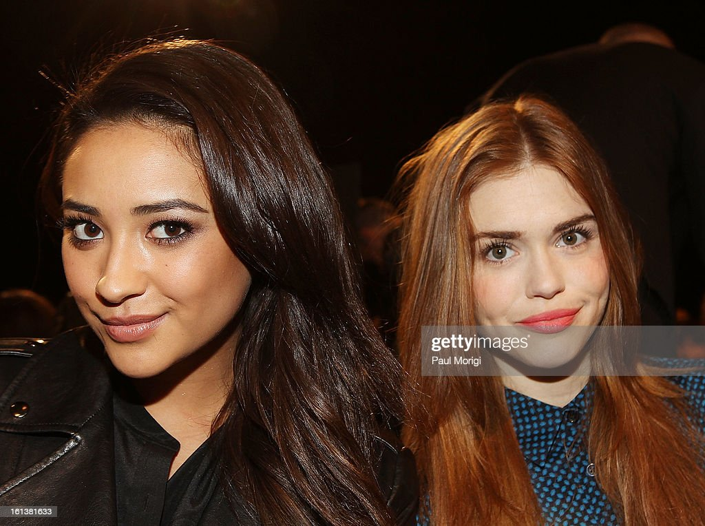 Actresses Shay Mitchell (L) and Holland Roden attend DKNY Women's during Fall 2013 Mercedes-Benz Fashion Week on February 10, 2013 in New York City.