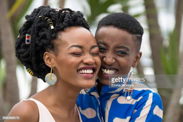 Actresses Sheila Munyiva is kissed by Samantha Mugatsia at the photocall for 'Rafiki' during the 71st annual Cannes Film Festival at Palais des...