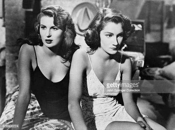 Actresses Silvana Mangano and Doris Dowling wear slips for their role in Bitter Rice