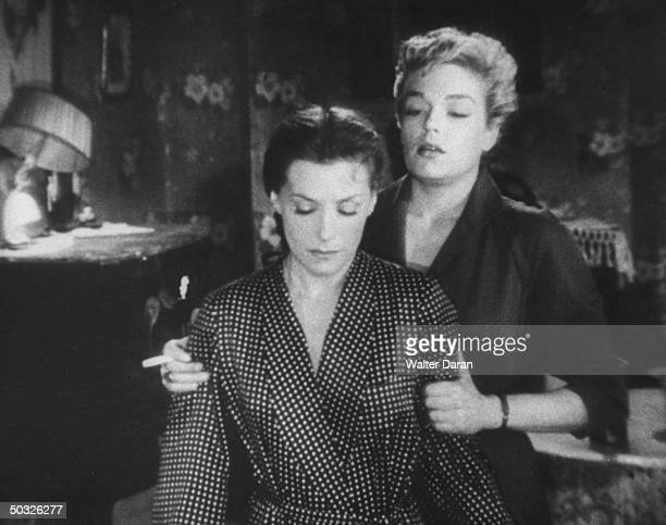 Actresses Simone Signoret and Vera Clouzot acting in a scene from the movie Diabolique