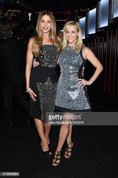 Actresses Sofia Vergara and Reese Witherspoon pose backstage during the 50th Academy Of Country Music Awards at ATT Stadium on April 19 2015 in...