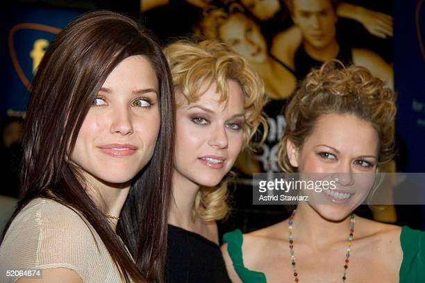 Actresses Sophia Bush Hilarie Burton and Bethany Joy Lenz of 'One Tree Hill' pose during an appearance at the FYE music store to sign CD's of the...