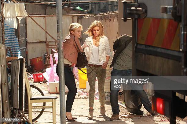 Actresses Sophia Myles and Nicola Peltz are seen on set filming Transfomers 4 Age of Extinction on October 24 2013 in Hong Kong Hong Kong