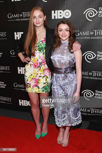 Actresses Sophie Turner and Maisie Williams attend the 'Game Of Thrones' The Exhibition New York Opening at 3 West 57th Avenue on March 27 2013 in...