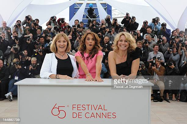 Actresses Susse Wold Alexandra Rapaport and Anne Louise Hassing pose at the Jagten Photocall during the 65th Annual Cannes Film Festival at Palais...