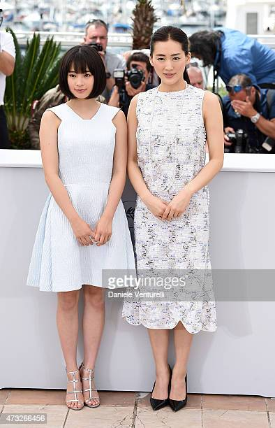 Actresses Suzu Hirose and Haruka Ayase attend the 'Umimachi Diary' photocall during the 68th annual Cannes Film Festival on May 14 2015 in Cannes...