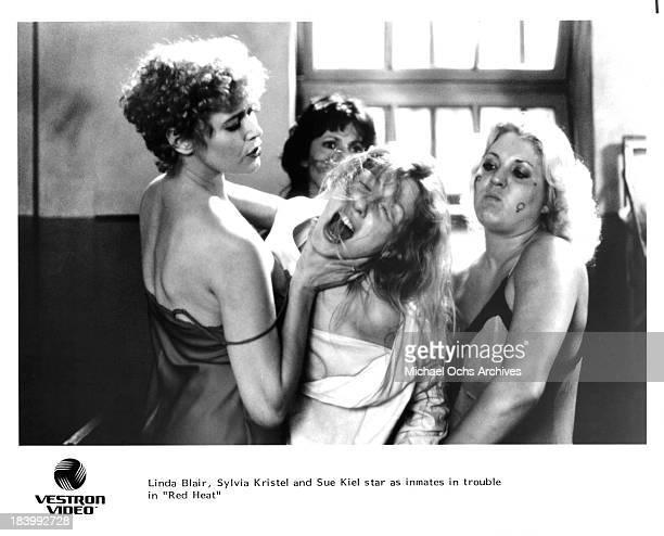 Actresses Sylvia Kristel Linda Blair and Sue Kiel on set of the movie Red Heat in 1985