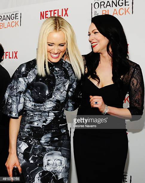 Actresses Taylor Schilling and Laura Prepon attend the Orange Is The New Black season two premiere at Ziegfeld Theater on May 15 2014 in New York City