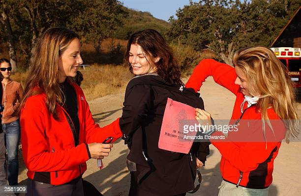 Actresses Tea Leoni and Kim Raver help Jeanne Tripplehorn pin on her name tag for the 8th Annual Expedition Inspiration TakeAHike at Paramount Ranch...