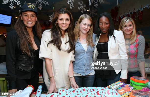 Actresses Tia Carrere Ali Landry Melissa Joan Hart Dawn Ballard and Kellie Martin attend the Baskin Robbins Wrapped With A Bow event at Giggles 'n...