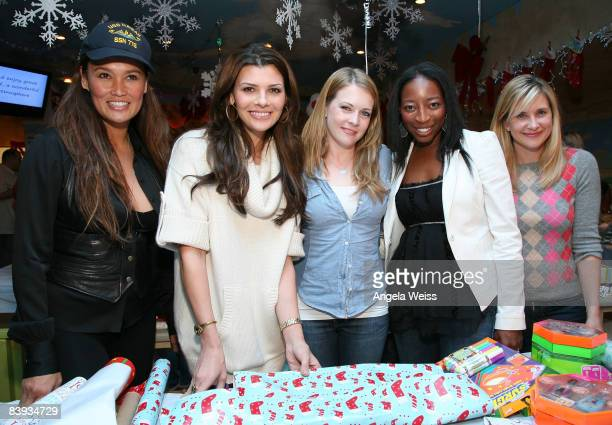 Actresses Tia Carrere Ali Landry Melissa Joan Hart Dawn Ballard and Kellie Martin attend the Baskin Robbins Wrapped With A Bow event at Giggles 'n'...