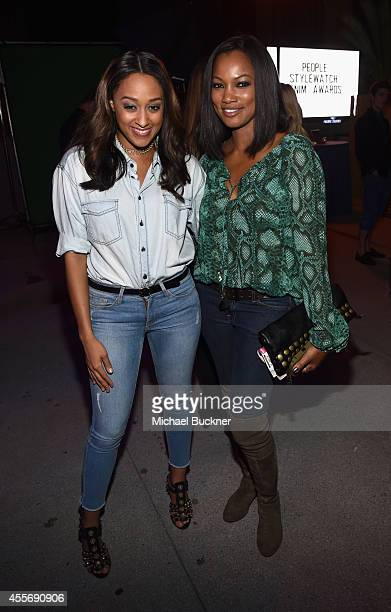 Actresses Tia Mowry and Garcelle Beauvais attend the People StyleWatch Denim Event at The Line on September 18 2014 in Los Angeles California