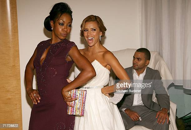 Actresses Tichina Arnold and Eva Longoria pose as they and NBA player Tony Parker prepare to leave the 10th Annual Entertainment Tonight Emmy Party...