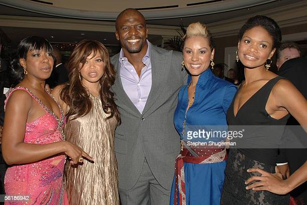 Actresses Tichina Arnold Tisha Campbell actor Terry Crews designer Nikki Chu and actress Kimberly Elise pose for photos during the reception for...