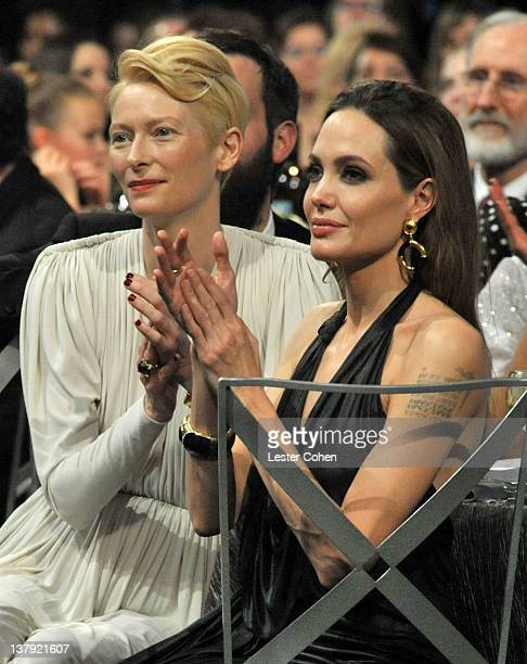 Actresses Tilda Swinton and Angelina Jolie attend The 18th Annual Screen Actors Guild Awards broadcast on TNT/TBS at The Shrine Auditorium on January...