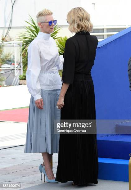 Actresses Tilda Swinton and Charlize Theron attend the 70th Anniversary Photocall during the 70th annual Cannes Film Festival at Palais des Festivals...