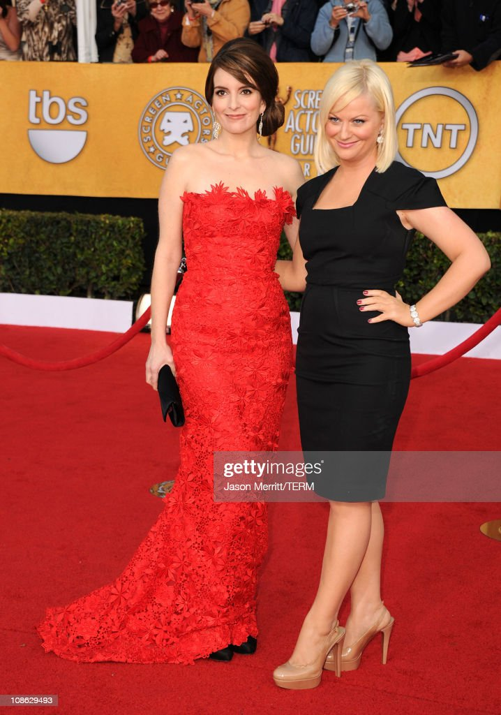 Actresses Tina Fey and Amy Poehler arrive at the 17th Annual Screen Actors Guild Awards held at The Shrine Auditorium on January 30, 2011 in Los Angeles, California.