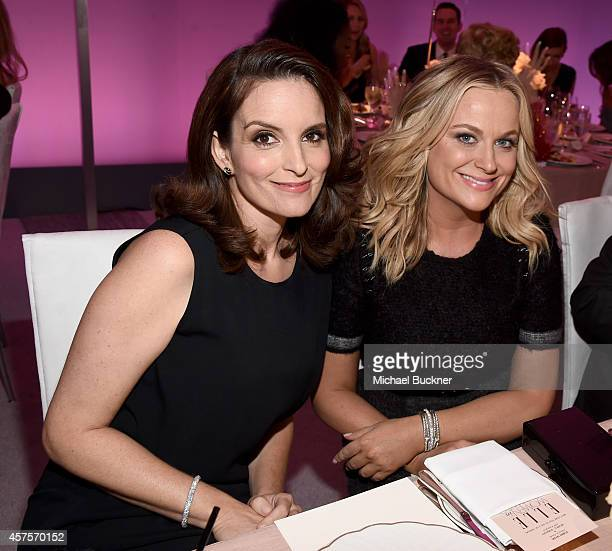 Actresses Tina Fey and Amy Poehler attend ELLE's 21st Annual Women in Hollywood Celebration at the Four Seasons Hotel on October 20 2014 in Beverly...