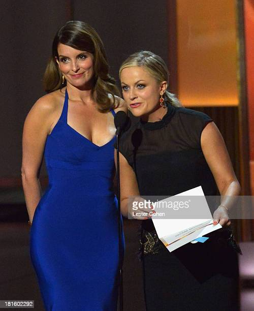 Actresses Tina Fey and Amy Poehler speak onstage during the 65th Annual Primetime Emmy Awards held at Nokia Theatre LA Live on September 22 2013 in...
