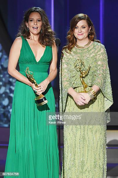 Actresses Tina Fey and Amy Poehler speak onstage during the 68th Annual Primetime Emmy Awards at Microsoft Theater on September 18, 2016 in Los...