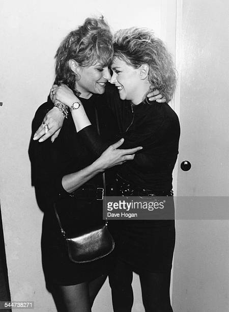 Actresses Tracy Ward and Leslie Ash hugging with their heads together after a gig Leslie played with the band 'The Business Connection' London May...