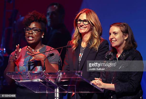Actresses Uzo Aduba Julia Roberts and Lena Dunham appear on stage during the Hillary Victory Fund Stronger Together concert at St James Theatre on...