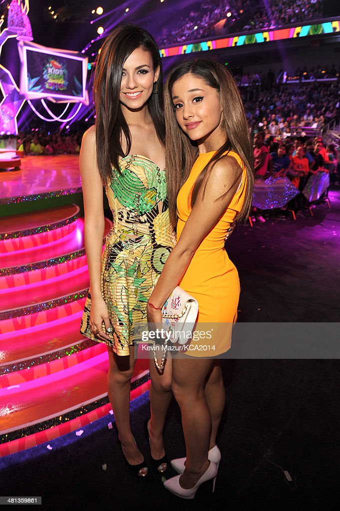 Actresses Victoria Justice (L) and Ariana Grande attend Nickelodeon's 27th Annual Kids' Choice Awards held at USC Galen Center on March 29, 2014 in Los Angeles, California.