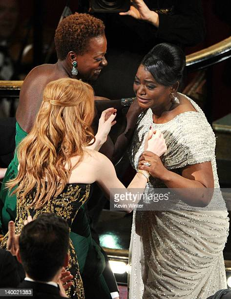Actresses Viola Davis and Jessica Chastain congratulate actress Octavia Spencer winner of the Best Supporting Actress Award for 'The Help' during the...