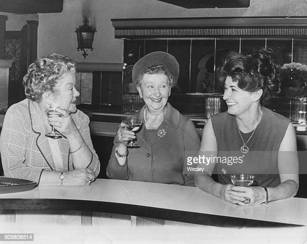 Actresses Violet Carson, Margot Bryant and Pat Phoenix, stars of the ITV soap opera 'Coronation Street', pictured having a drink at the bar during...