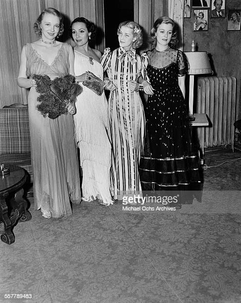 Actresses Virginia Bruce Dolores del Rio Anita Louise and Joan Bennett gather at a party in Los Angeles California