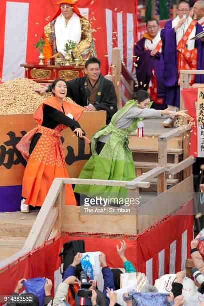 Actresses Wakana Aoi and Eri Tokunaga throws beans during the setsubun ceremony at Naritasan Fudoson Temple on February 3 2018 in Osaka Japan The...