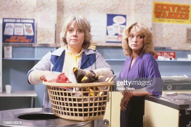 Actresses Wendy Richard and Gillian Taylforth pictured on the laundrette set of the BBC soap opera 'EastEnders' August 8th 1986
