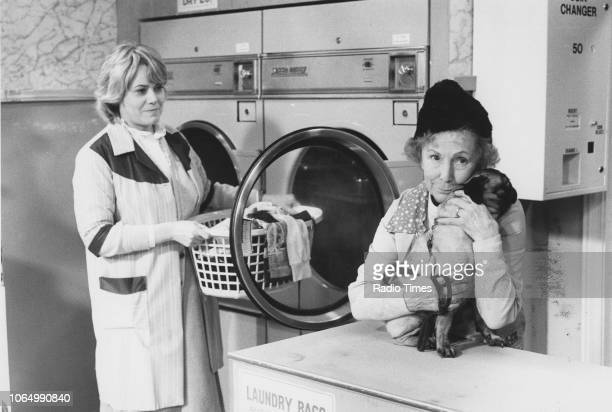 Actresses Wendy Richard and Gretchen Franklin in a laundrette scene from the television soap opera 'EastEnders' December 18th 1984