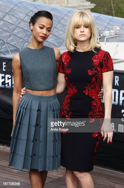 Actresses Zoe Saldana and Alice Eve attend a 'Star Trek Into Darkness' photocall at China Club on April 28 2013 in Berlin Germany