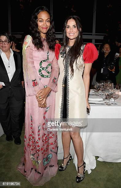 Actresses Zoe Saldana and Demi Moore both wearing Gucci attend the 2016 LACMA Art Film Gala Honoring Robert Irwin and Kathryn Bigelow Presented By...