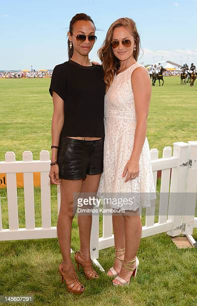 Actresses Zoe Saldana and Minka Kelly pose at the VIP Marquee during the fifth Annual Veuve Clicquot Polo Classic on June 2, 2012 in Jersey City.