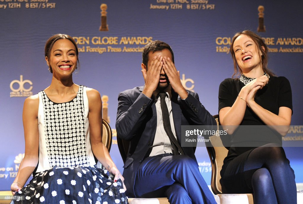 Actresses Zoe Saldana (L) and Olivia Wilde (R) react as actor Aziz Ansari covers his eyes while onstage at the 71st Golden Globe Awards Nominations Announcement at The Beverly Hilton Hotel on December 12, 2013 in Beverly Hills, California.
