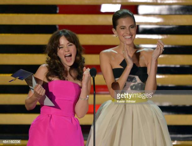 Actresses Zooey Deschanel and Allison Williams speak onstage at the 66th Annual Primetime Emmy Awards held at Nokia Theatre L.A. Live on August 25,...