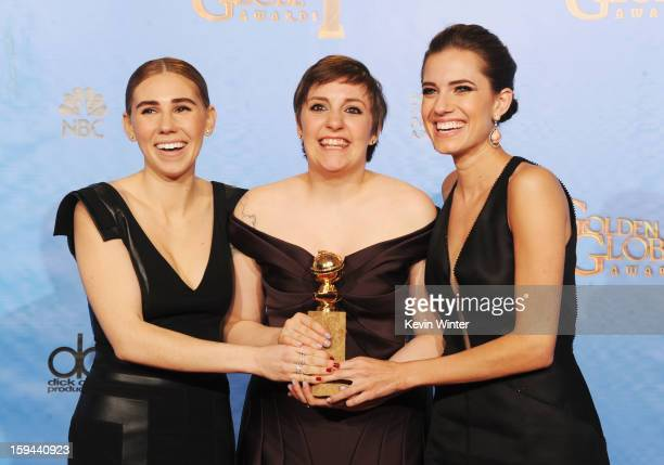 "Actresses Zosia Mamet, Lena Dunham and Allison Williams of ""Girls"" pose in the press room during the 70th Annual Golden Globe Awards held at The..."