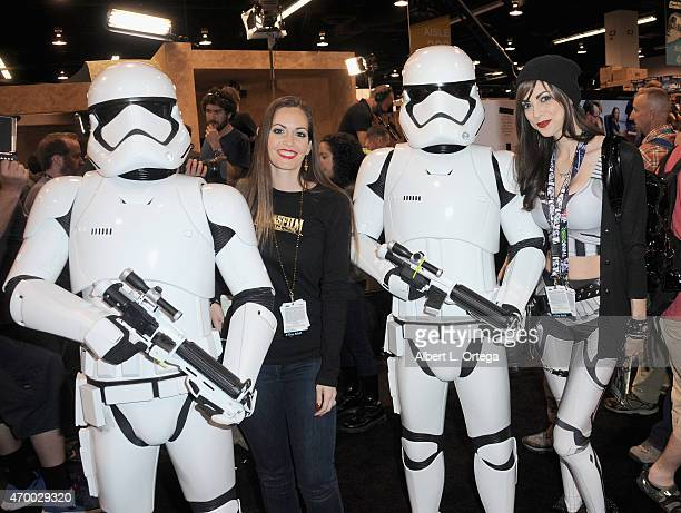 Actresses/cosplayers Stacey Bender and Leeanna Vamp pose with the new Storm Troopers from 'Star Wars The Force Awakens' at Day One of Disney's 2015...