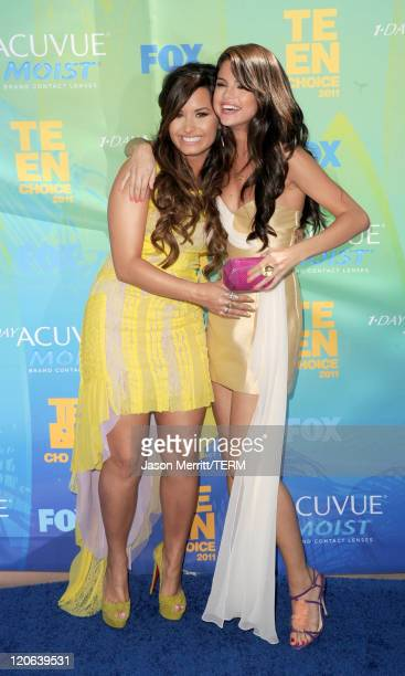 Actresses/singers Demi Lovato and Selena Gomez arrive at the 2011 Teen Choice Awards held at the Gibson Amphitheatre on August 7 2011 in Universal...