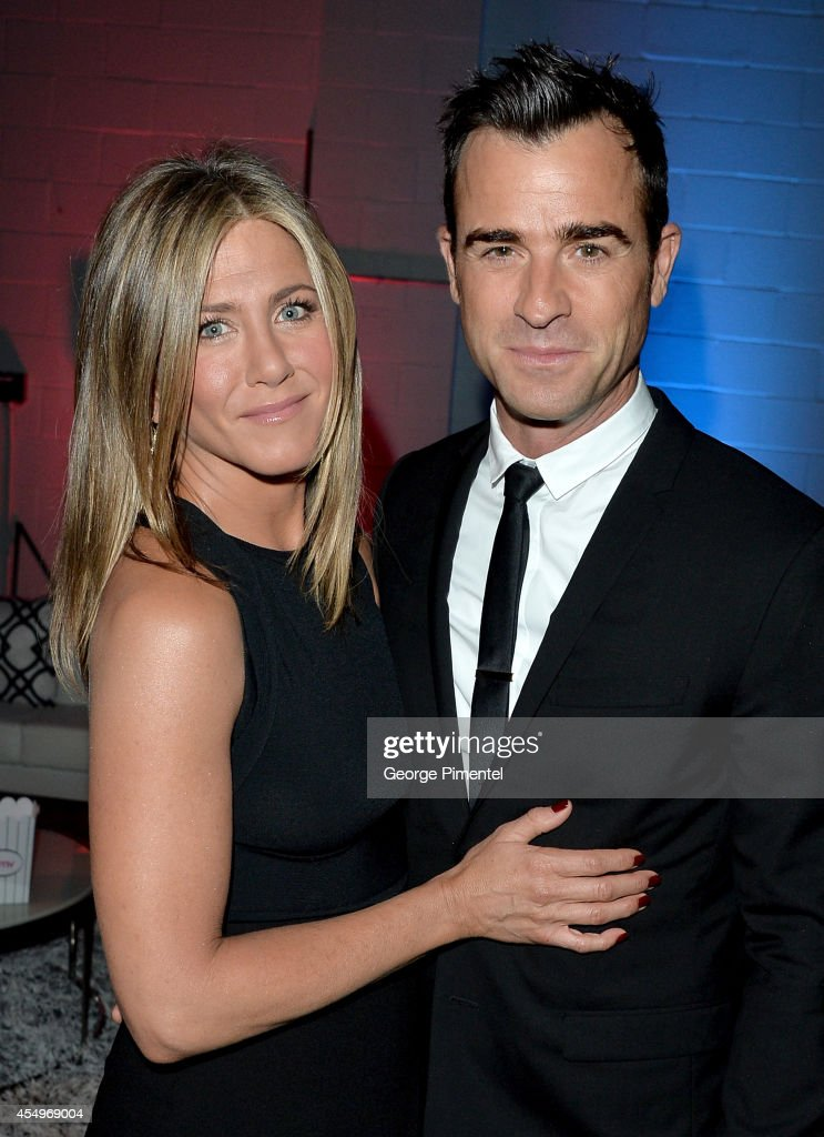 Actress/Executive Producer Jennifer Aniston (L) and actor Justin Theroux attend the 'Cake' premiere during the 2014 Toronto International Film Festival at The Elgin on September 8, 2014 in Toronto, Canada.