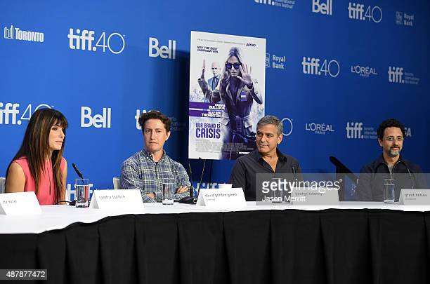 Actress/executive producer Sandra Bullock director David Gordon Green producers George Clooney and Grant Heslov speak onstage during the 'Our Brand...