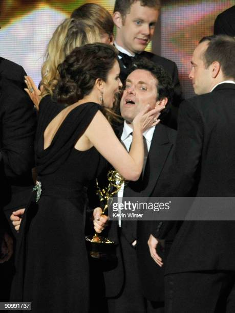 Actress/executive producer Tina Fey for '30 Rock' speaks to one of her colleagues onstage after winning their Emmy for Outstanding Comedy Series for...