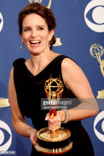 "Actress/executive producer Tina Fey poses in the press room with her Emmy for Outstanding Comedy Series for ""30 Rock"" at the 61st Primetime Emmy..."