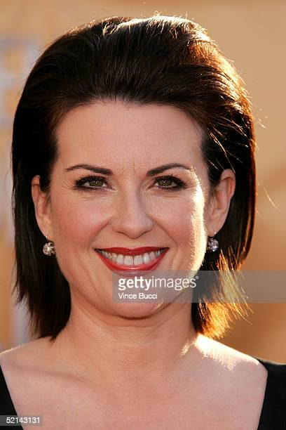 ActressMegan Mullally arrives at the 11th Annual Screen Actors Guild Awards at the Shrine Exposition Center on February 5, 2005 in Los Angeles,...