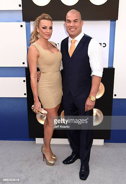 Actress/model Amber Nichole Miller and mixed martial artist Tito Ortiz attend The Comedy Central Roast of Justin Bieber at Sony Pictures Studios on...