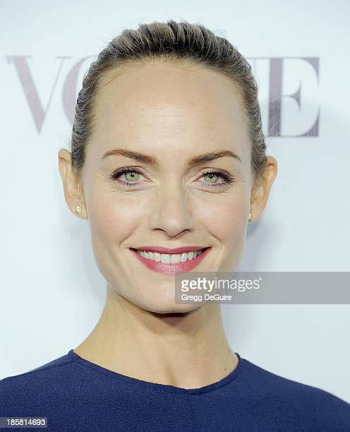 Actress/model Amber Valletta arrives at the Dream For Future Africa Foundation Gala at Spago on October 24, 2013 in Beverly Hills, California.