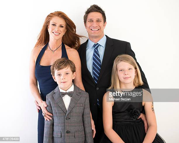 Actress/Model Angie Everhart Carl Ferro Kayden Everhart and JoAnn Ferro pose for portrait at The SAP the Starving Artists Project portraits on June...